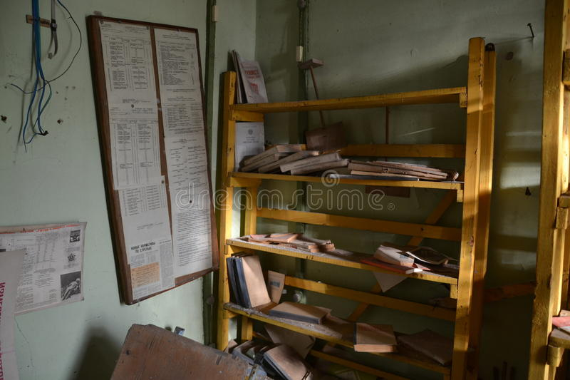 Book shelf with books. In abandoned school in ghost town Pripyat, Chernobyl zone royalty free stock image