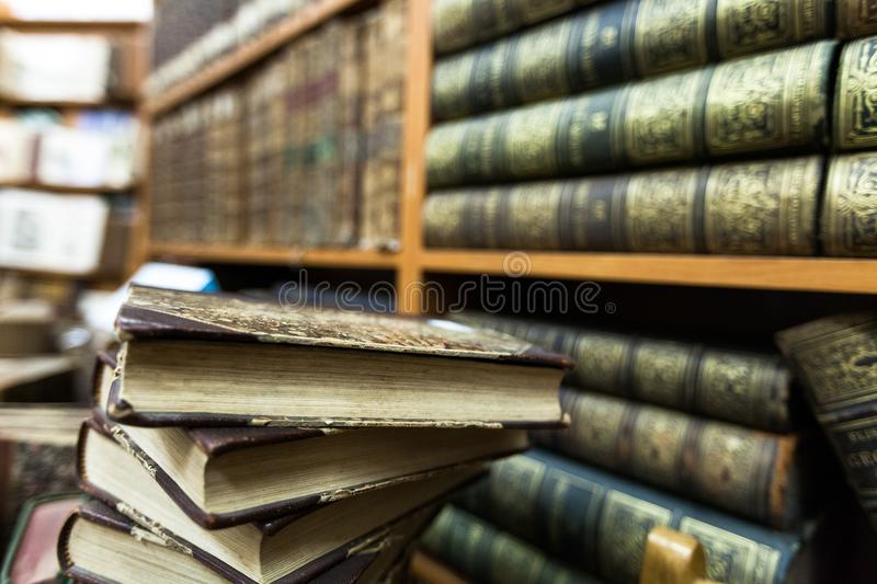 Book stack and book shelf in a library. Book education literature erudition book collection library archive stock images