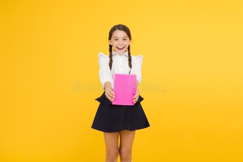 Book store. cheerful girl with workbook. Education. reading story. childrens literature. kid learning grammar. back to. School. dictionary notebook. Get stock photography