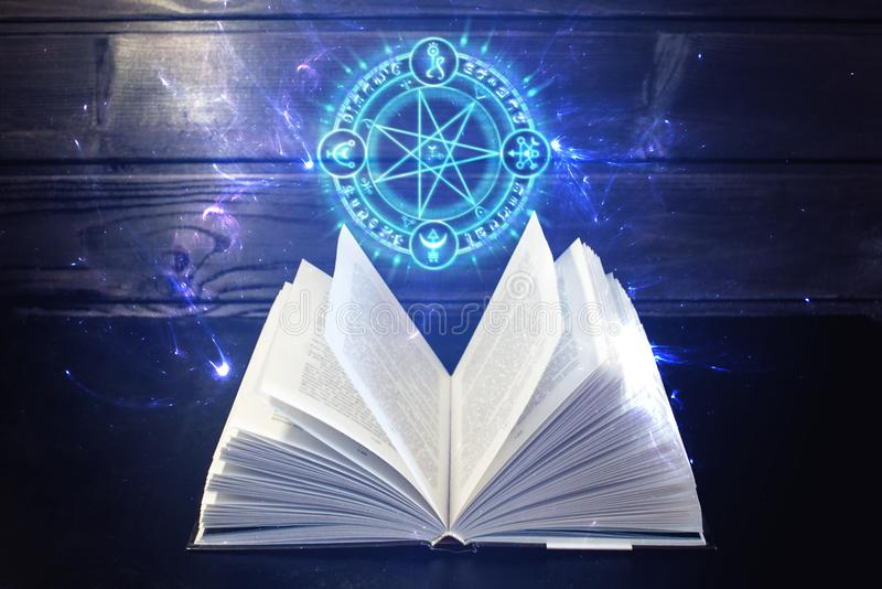 Magia Arcana e Corrupção Book-table-out-comes-light-magic-sign-open-magical-book-pages-like-fan-table-out-comes-colorful-87641891