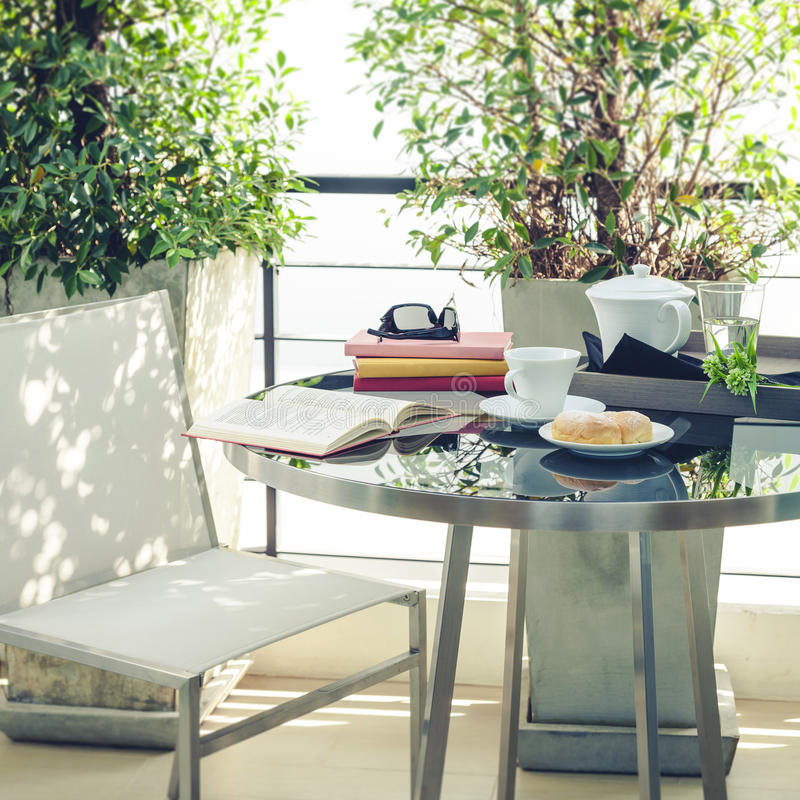 Download Book On Table Outdoor Terrace Home Decoration Stock Photo