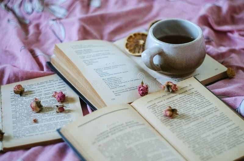 Book, tea, roses. Cup art deco a cup. book tea. roses stock photos