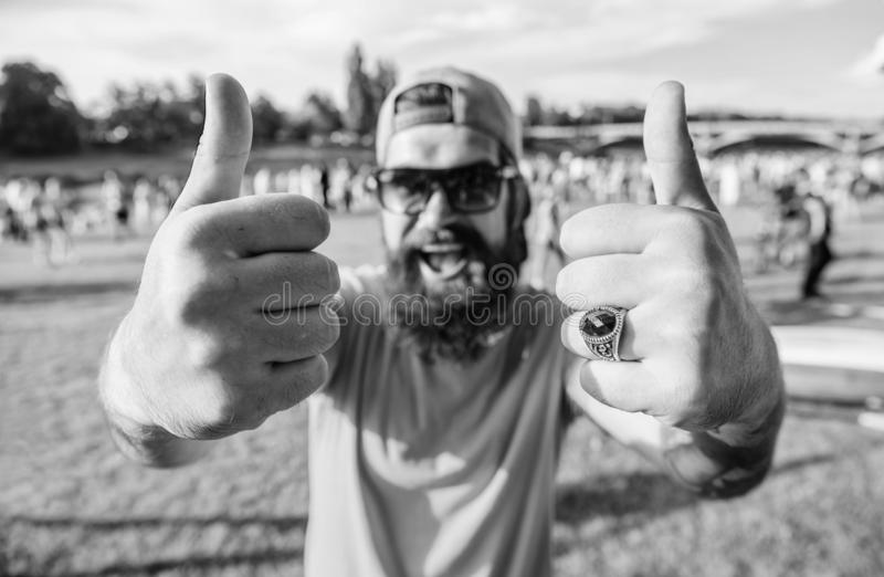 Book ticket now summer festival. Highly recommend top list events. Hipster visiting event picnic fest or festival. Man. Cheerful face shows thumb up. Man royalty free stock photos