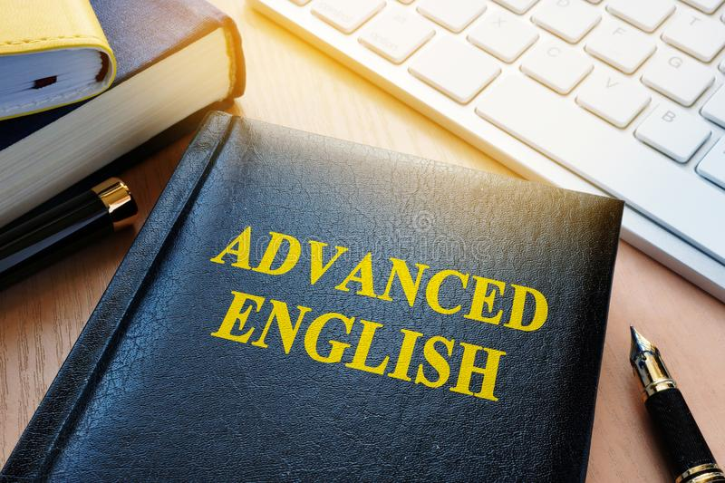 Book with title advanced english. Language learning concept stock image