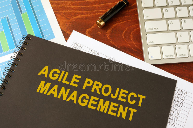 Book with title agile project management. Book with title agile project management in an office stock photo
