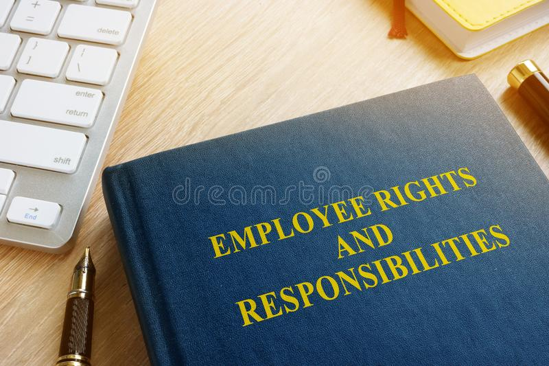 Book with title Employee rights and responsibilities. stock photo