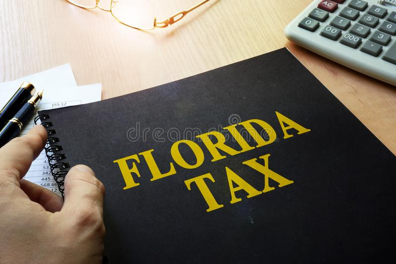 Book with title Florida tax. stock photo