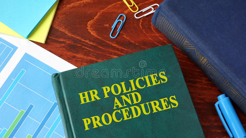 Book with title HR policies and procedures. Book with title HR policies and procedures on a table stock image