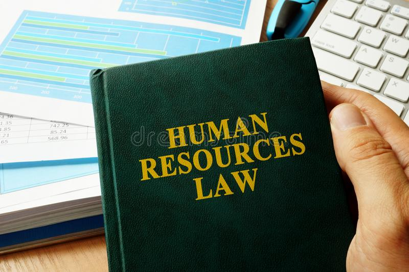 Book with title Human Resources HR Law. Book with title Human Resources HR Law on an office desk stock photos