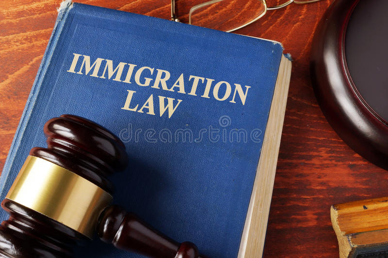 Book with title immigration law. On a table royalty free stock photo
