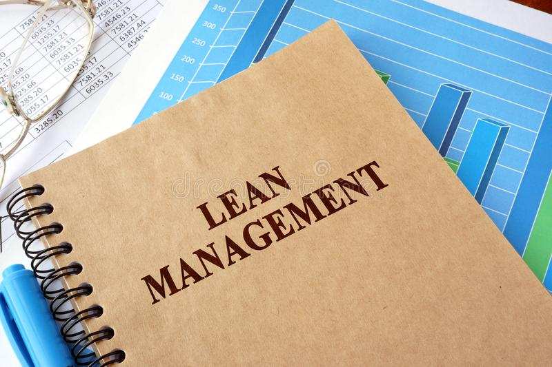 Book with title lean management on a table. royalty free stock photo