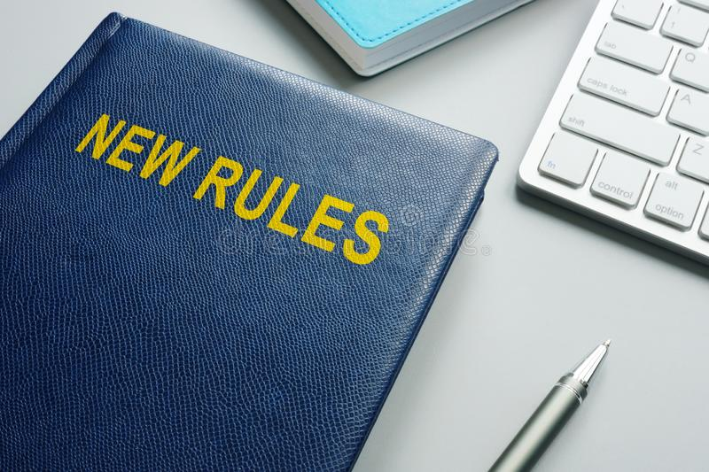 Book with title New rules and regulations royalty free stock photos