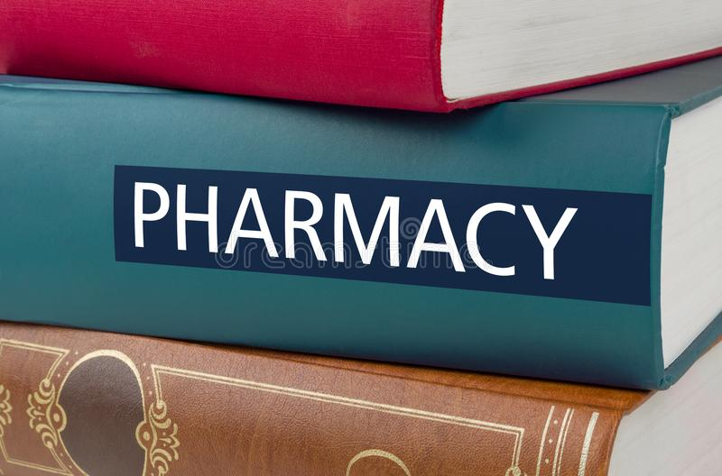 Book with the title Pharmacy written on the spine stock photography