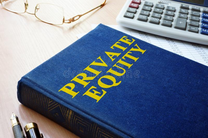 Book with title private equity. Book with title private equity and calculator royalty free stock image