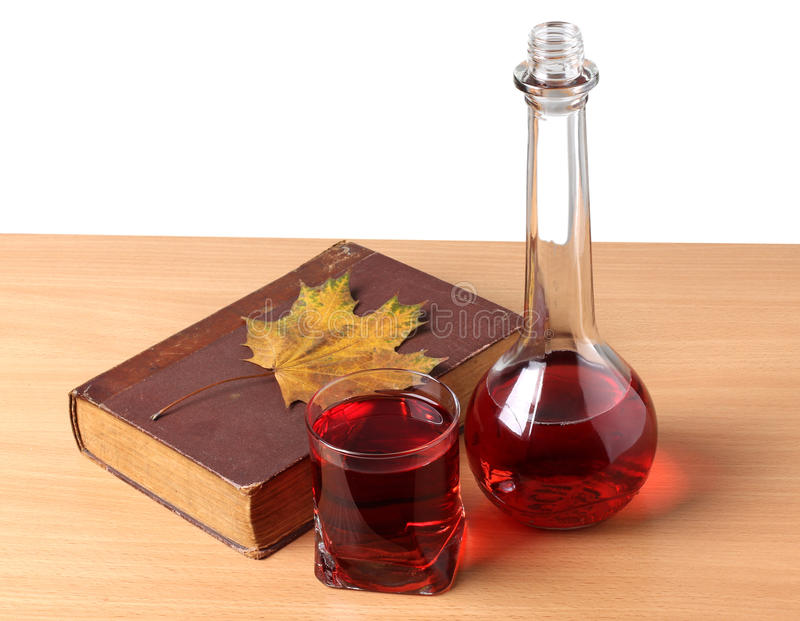 Book and wineglasse. Color photo of a glass of wine and book stock photos