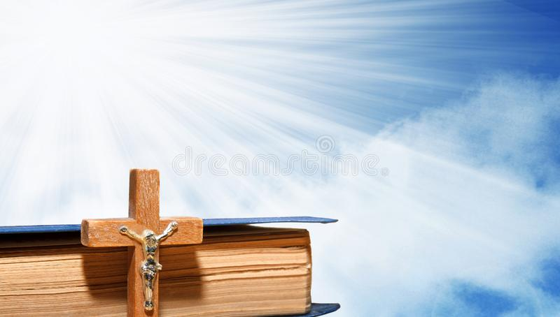 Book and a wooden cross stock image