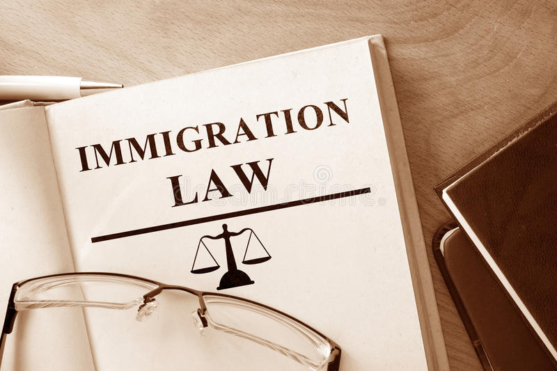 Book with words Immigration Law. Book with words Immigration Law and glasses stock images