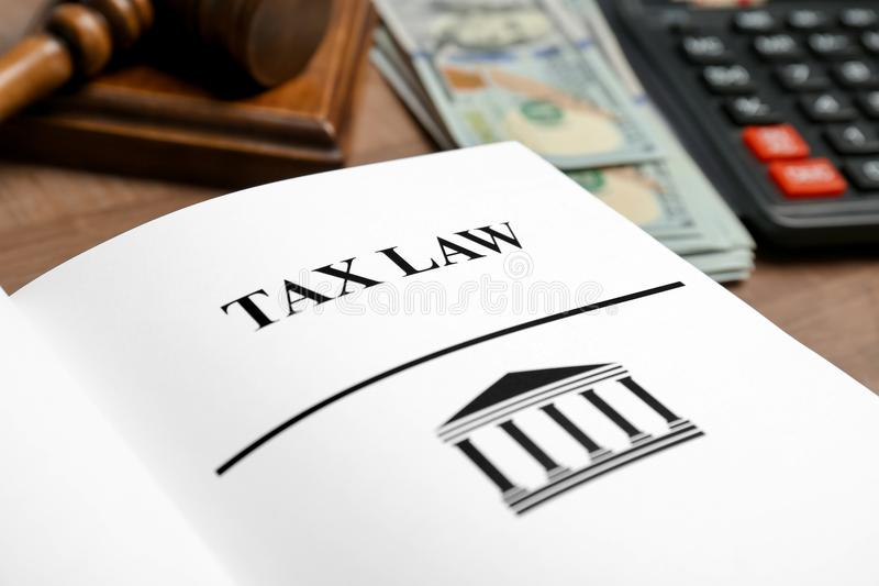 Book with words TAX LAW on table. Closeup royalty free stock image