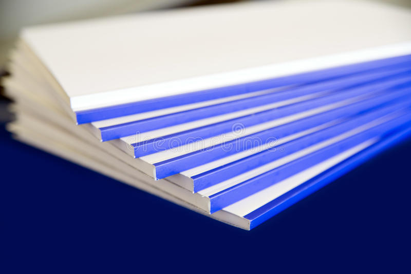 Bookbinding. Details of books that are being bound in Italian industry royalty free stock photo