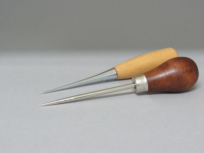 The bookbinding process. The bookbinding tools royalty free stock photo
