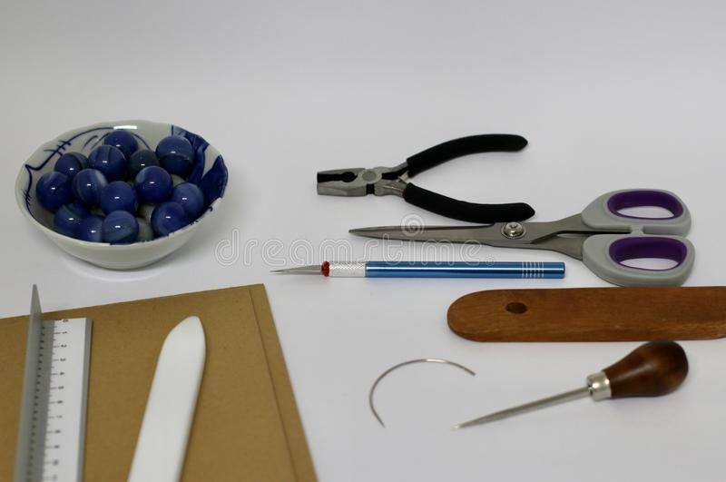 The bookbinding process. The bookbinding tools royalty free stock image
