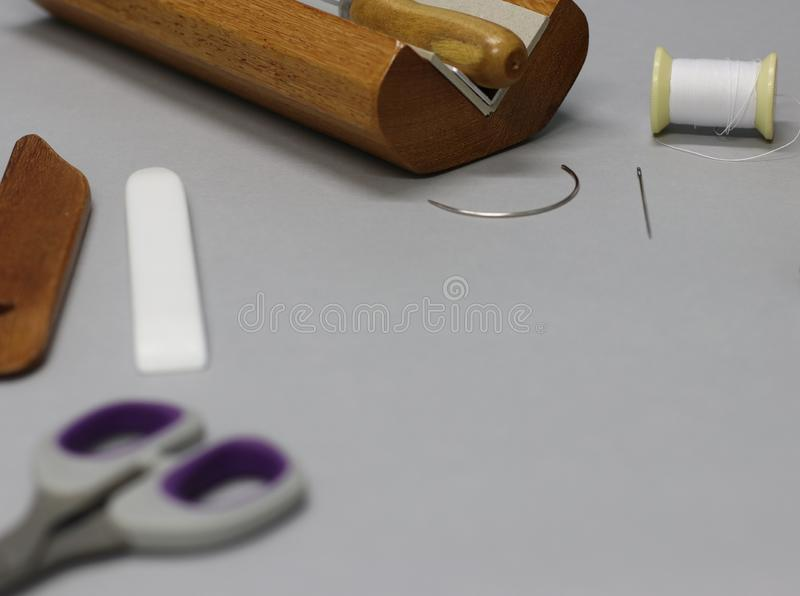 The bookbinding process. The bookbinding tools royalty free stock images