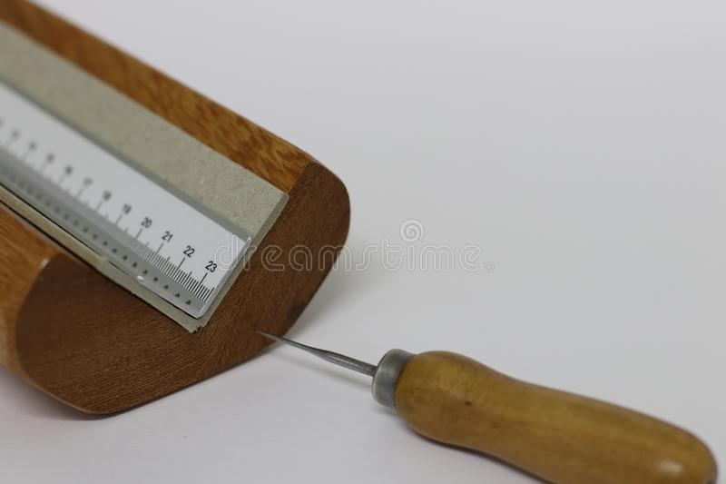 The bookbinding process. Bookbinding work tools stock photos