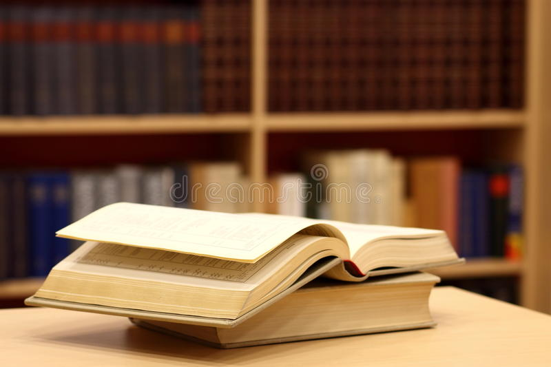 Bookcase with books stock photos