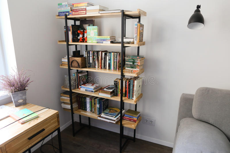 Bookcase in furnished office for work or leisure in spacious roo royalty free stock photo