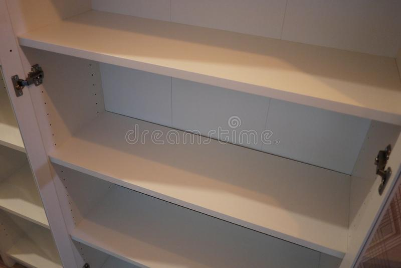 Bookcase in the interior of the apartment. stock photography