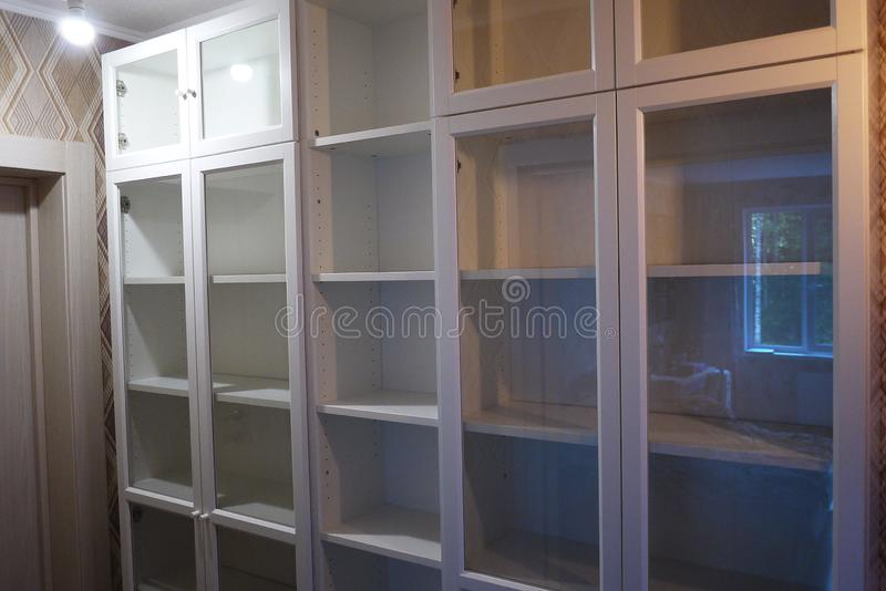 Bookcase in the interior of the apartment. stock photos