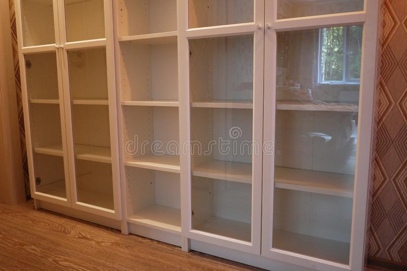 Bookcase in the interior of the apartment. royalty free stock image