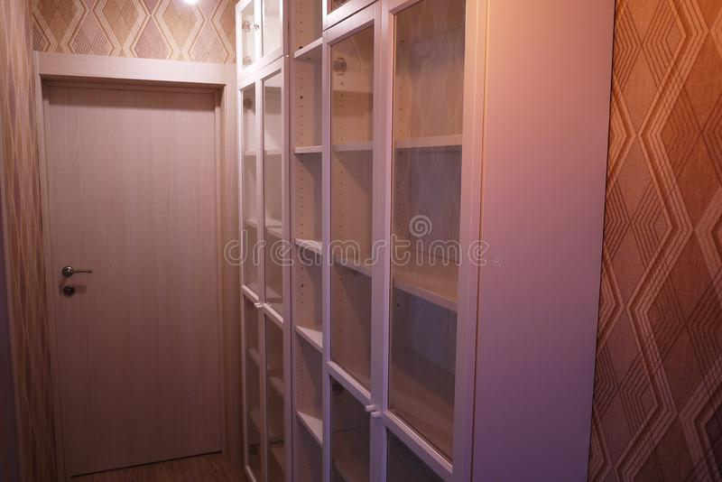 Bookcase in the interior of the apartment. royalty free stock images