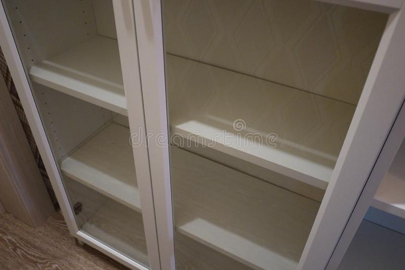 Bookcase in the interior of the apartment. stock image