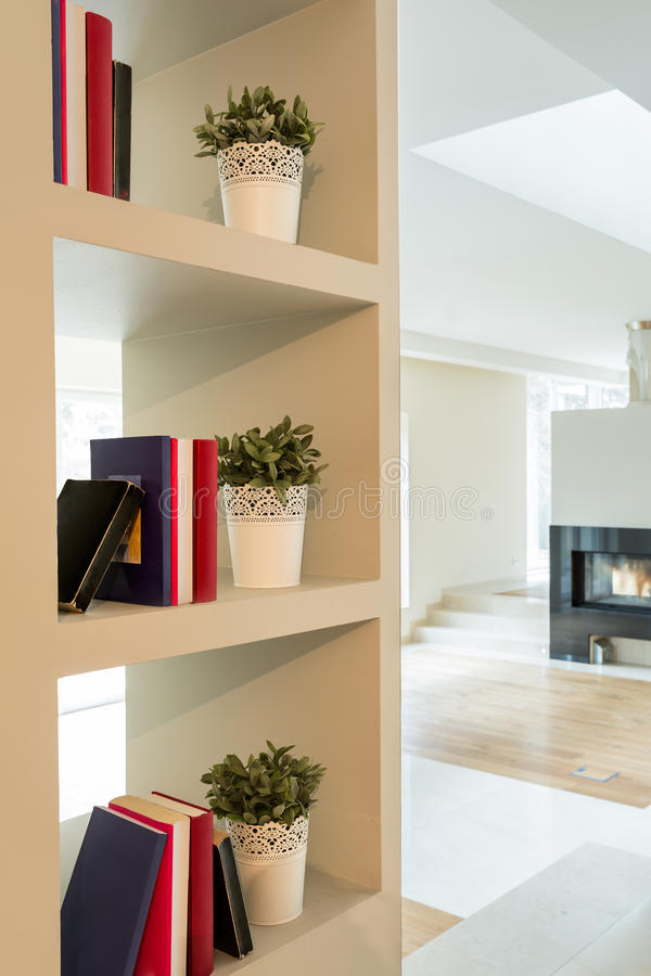 Bookcase in modern interior royalty free stock photos