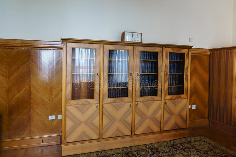 Bookcase in the office of Stalin`s apartment in the Yusupov Palace. On the shelves is the complete works of Lenin stock photography
