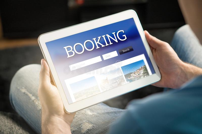 Booking app or website on tablet screen. royalty free stock photo