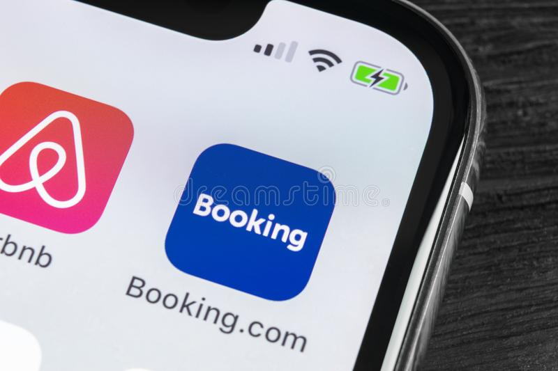 Booking.com application icon on Apple iPhone X screen close-up. Booking app icon. Booking.com. Social media app. Social network. Sankt-Petersburg, Russia, April royalty free stock photos