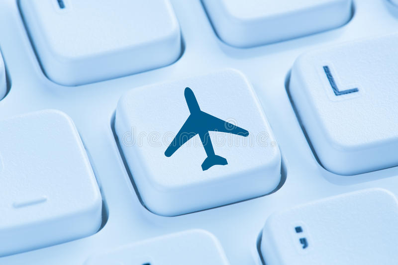 Booking flight holidays vacation online shopping e-commerce internet travel shop blue computer keyboard stock photos