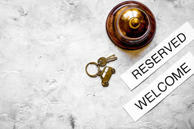 Booking form for hotel room reservation stone background top vie. Booking form for hotel room reservation on stone table background top view space for text royalty free stock photo
