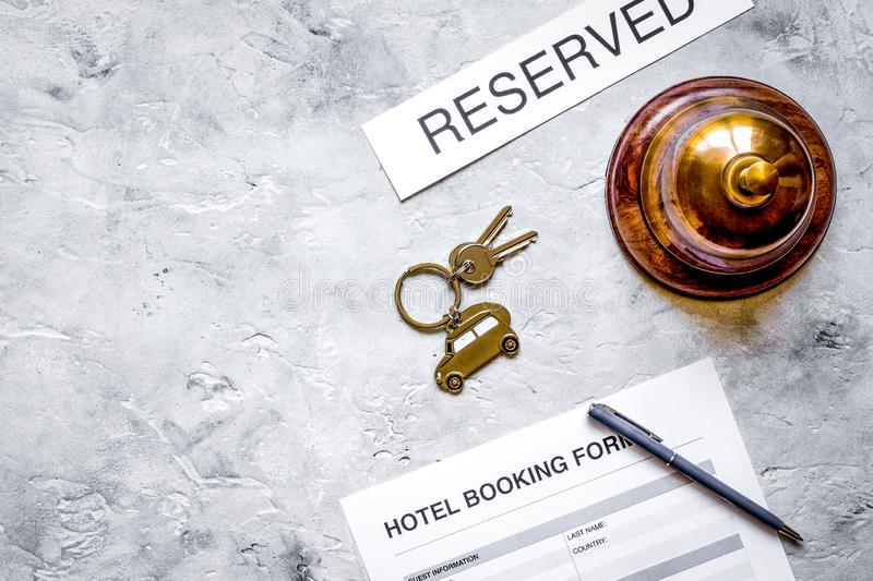 Booking form for hotel room reservation stone background top view space for text. Booking form for hotel room reservation on stone table background top view royalty free stock photo