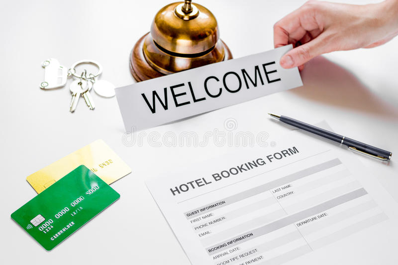 Booking form for hotel room reservation white background. Booking form for hotel room reservation on white table background royalty free stock photo