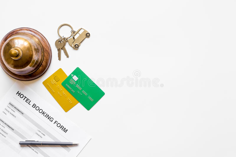 Booking form for hotel room reservation white background top view space for text. Booking form for hotel room reservation on white table background top view stock photos