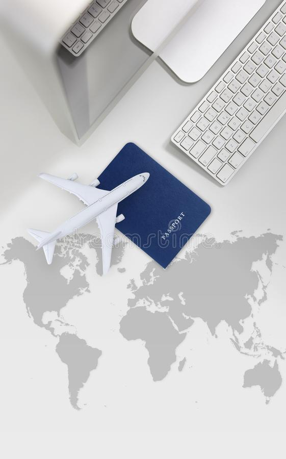 Booking and search flight ticket air international travel concept, computer,passport and airplane isolated on desk background with. Global map stock image