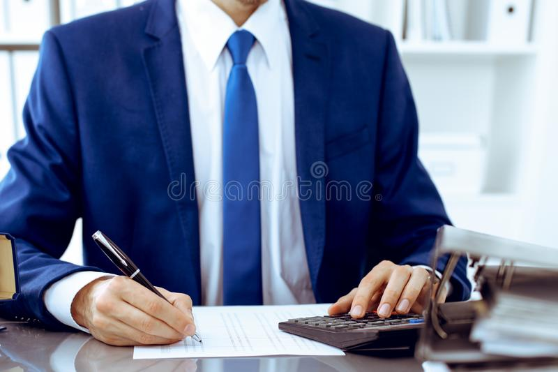 Bookkeeper or financial inspector hands making report, calculating or checking balance. Internal Revenue Service. Inspector man checking financial document stock images