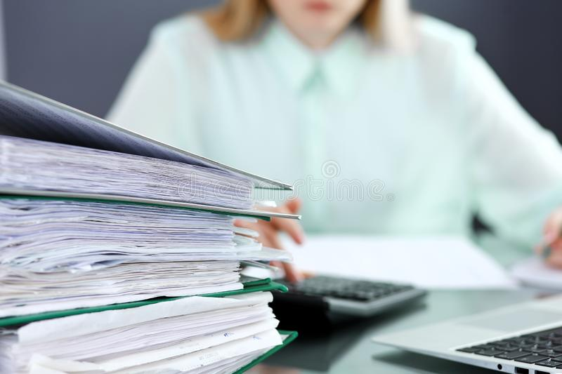 Bookkeeper or financial inspector making report, calculating or checking balance. Audit and tax service concept. Green royalty free stock photos
