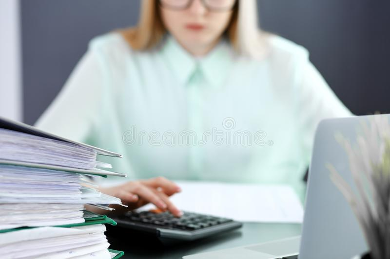 Bookkeeper or financial inspector making report, calculating or checking balance. Audit and tax service concept. Green stock photo