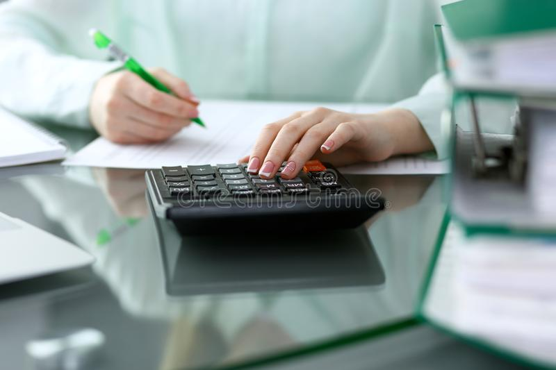 Bookkeeper or financial inspector making report, calculating or checking balance. Audit and tax service concept. Gree royalty free stock images