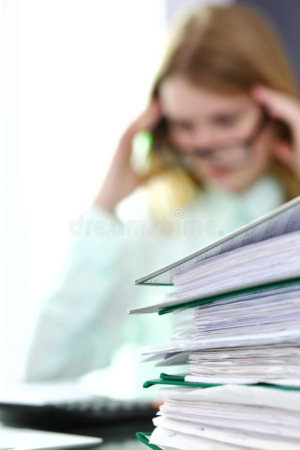 Bookkeeper or financial inspector making report, calculating or checking balance. Audit and tax service concept. Green. Colored image background stock photo