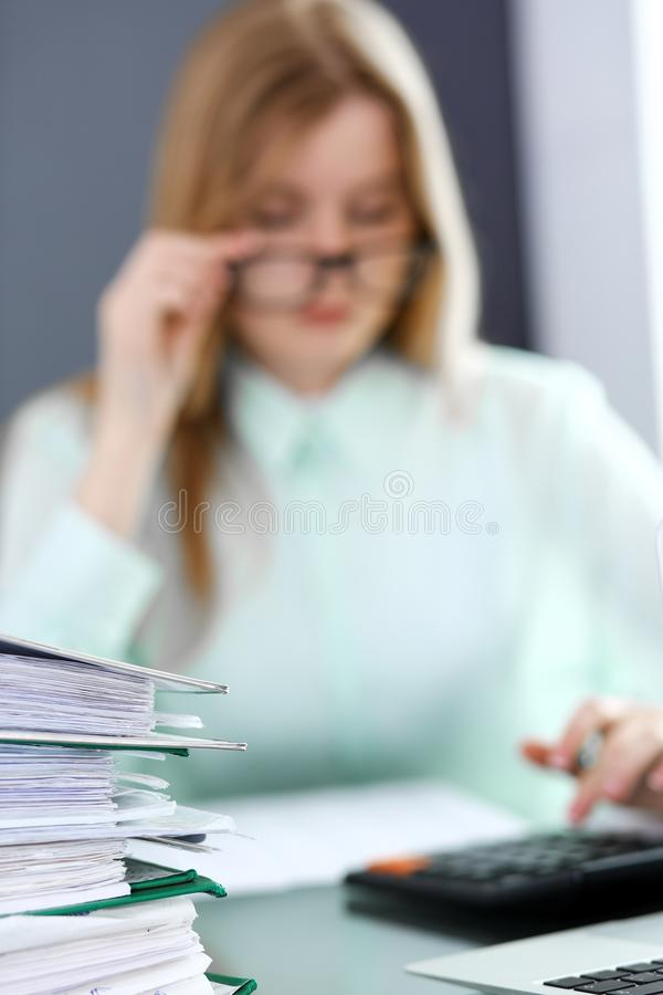 Bookkeeper or financial inspector making report, calculating or checking balance. Audit and tax service concept. Green stock image